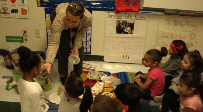 """It smells just like wet forest"" Trinity K students learn how to sort their waste and what compost is."